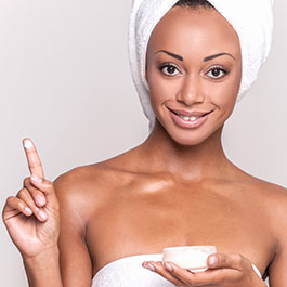 Beautiful Woman Holding Face Cream